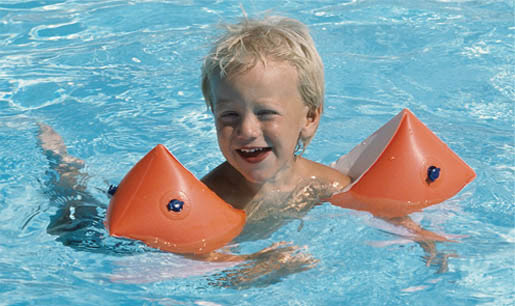 Toddler swimming with armbands